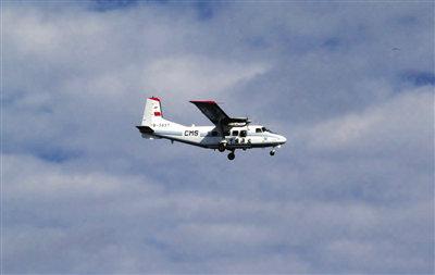 资料图:日方拍摄的正在巡航钓鱼岛的中国海监飞机。